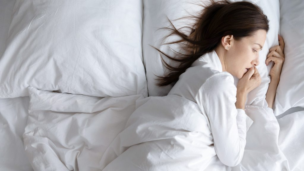 Worrying woman in her bed
